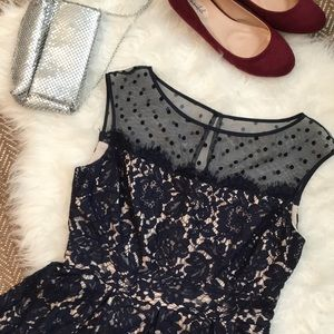 Navy blue lace dress with polka dot illusion neck